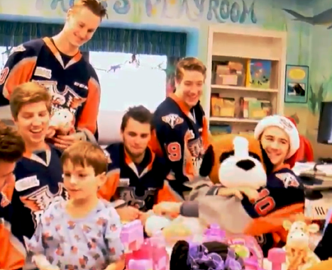 Flint Firebirds players bring stuffed toy animals to sick kids clinic